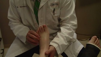 Dr. Gent examining my left foot/right foot in cast