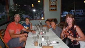 Kim with Mark and his children at River Dance Lodge Dining